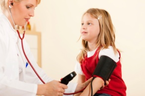Doctor measuring blood pressure of child